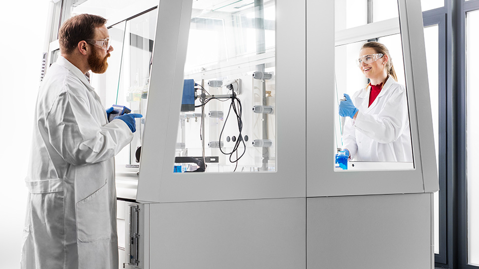 Two people standing in a laboratory